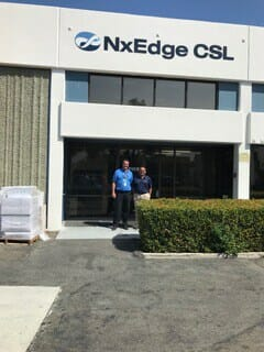 Two men standing outside of NxEdge CSL building