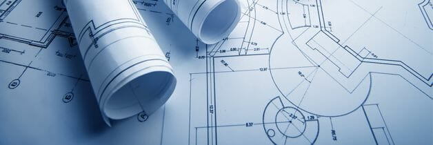 Blue CAD drawings laid out with engineering plans